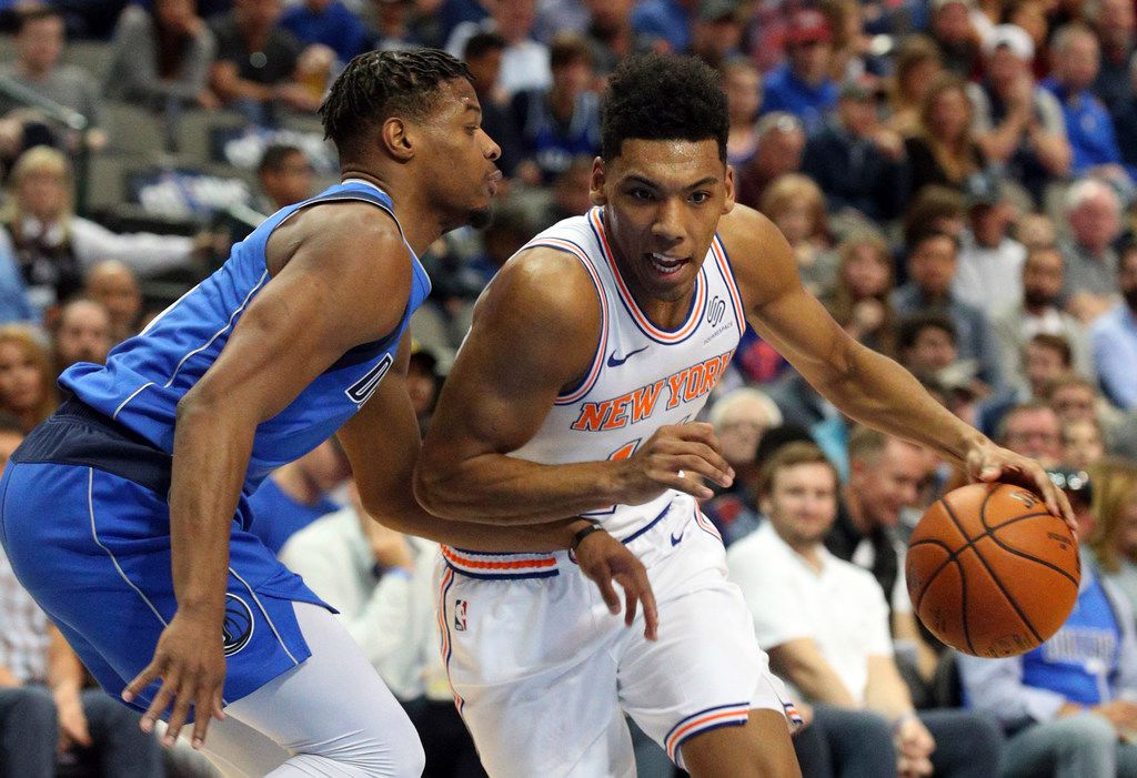 Dallas Mavericks guard Dennis Smith Jr. (1) defends as New York Knicks guard Allonzo Trier (14) tries to drive the ball past in the first half of an NBA basketball game Friday, Nov. 2, 2018, in Dallas. (AP Photo/Richard W. Rodriguez)