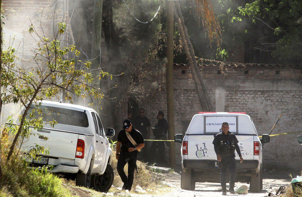 Forensic personnel and police officers are seen outside a criminal hideout where eight people with signs of torture were found alive along with four dead ones, in Tlajomulco de Zuniga, Jalisco State, Mexico, on May 3, 2019. Mexican authorities freed 17 kidnapped people in two different cases in the western Mexican state of Jalisco, which has been hit by violence linked to organized crime. Along with the ones found in Tlajomulco, nine other people were also rescued alive from another safe house in Guadalajara.
