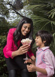 Yasmeen Tadia snacked onpopcorn when she was growing up. Now, she shares the experience with her son, Zain, with HotPoppin gourmet popcorn.(Kye Lee/Special Contributor)