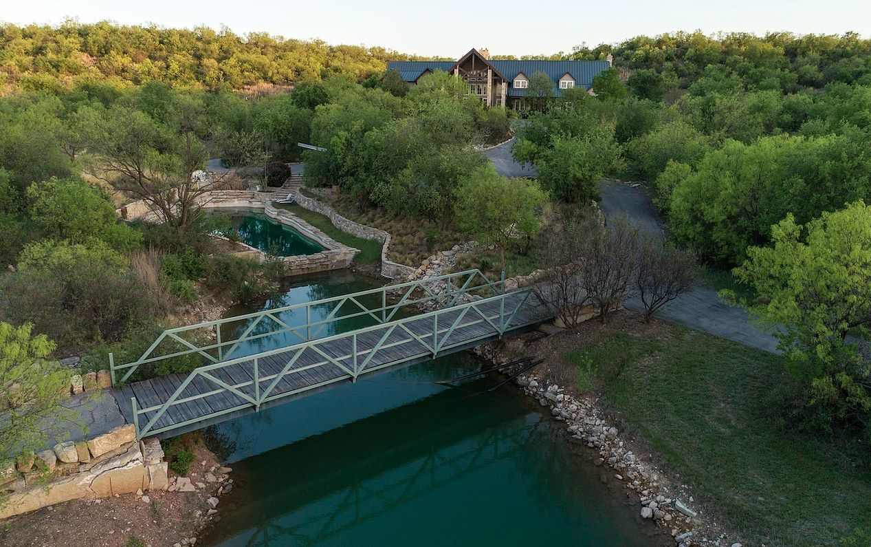 The ranch has two small lakes and a rock bottom swimming pool.