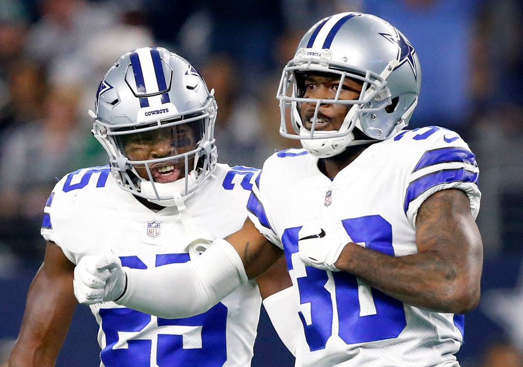 FILE - Cowboys safety Xavier Woods (25, left) celebrates a pass breakup by cornerback Anthony Brown (30) during the fourth quarter of a game against the Philadelphia Eagles at AT&T Stadium in Arlington on Sunday, Dec. 9, 2018. (Tom Fox/The Dallas Morning News)
