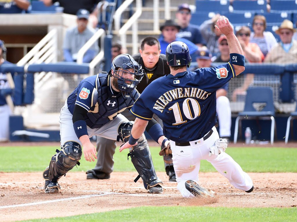 PHOENIX, AZ - MARCH 07:  Derek Norris #3 of the San Diego Padres tags out Kirk Nieuwenhuis #10 of the Milwaukee Brewers at home plate during the second inning of a spring training game at Maryvale Baseball Park on March 7, 2016 in Phoenix, Arizona.  (Photo by Norm Hall/Getty Images)