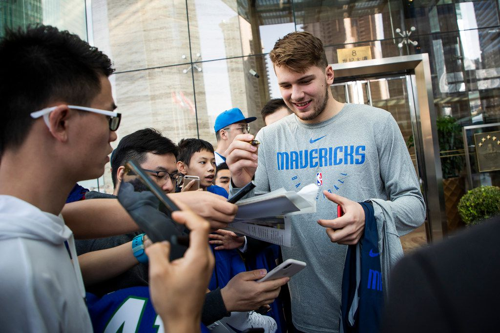 FILE - Dallas Mavericks guard Luka Doncic signs autographs for fans as the team departs their hotel for practice on Wednesday, Oct. 3, 2018, in Shanghai. The Mavericks will face the Philadelphia 76ers in Shanghai on Oct. 5th in the first of two NBA China Games 2018 preseason basketball games. (Smiley N. Pool/The Dallas Morning News)