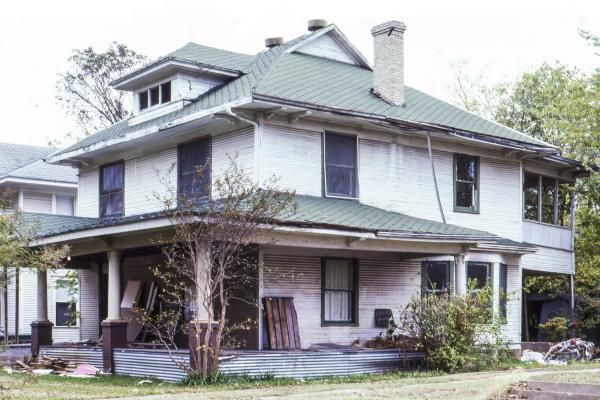 """""""Before"""" photo of a house in Munger Place that was saved from the wrecking ball by the revolving fund set up by preservationist Virginia Savage McAlester and others."""