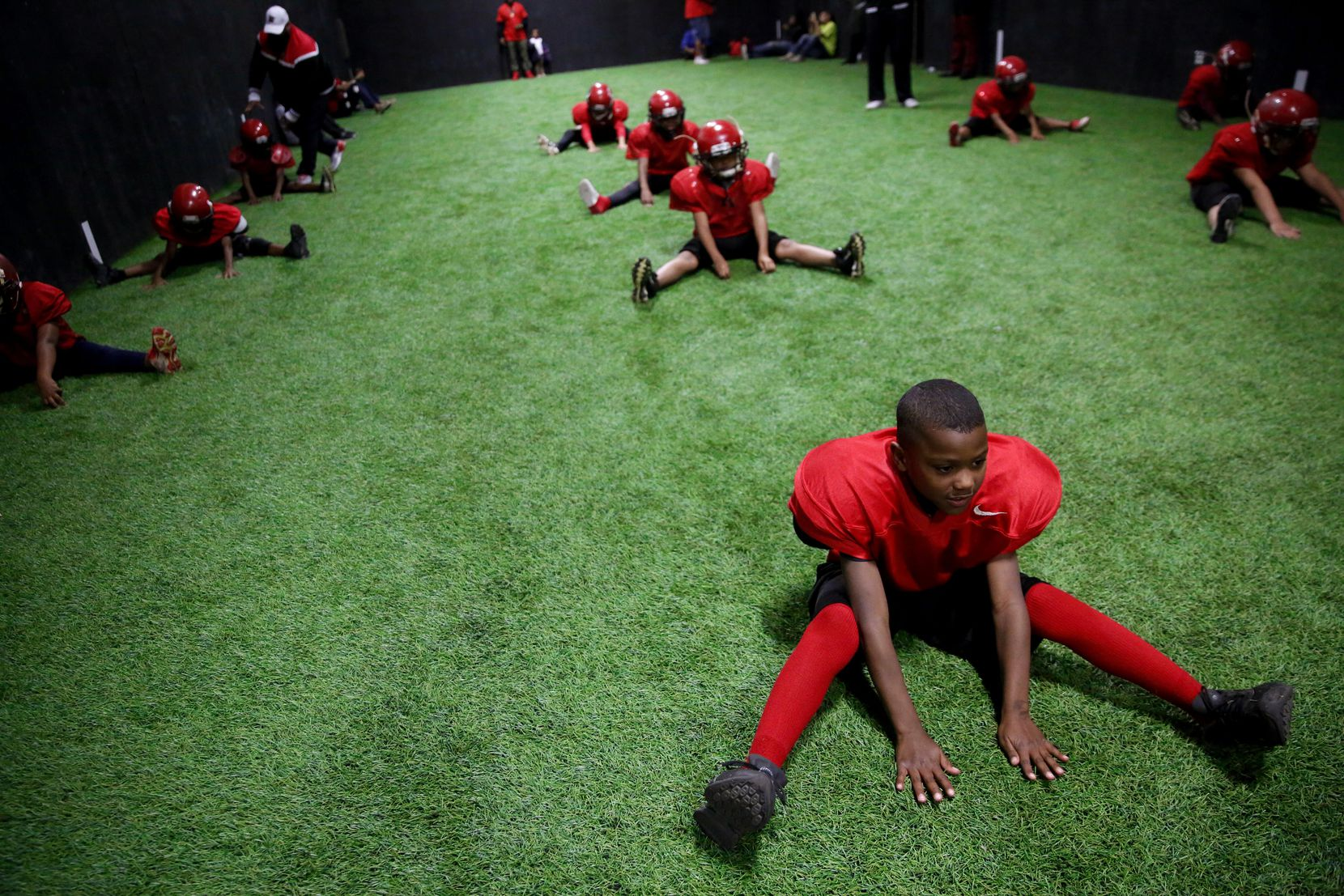 Marquay Jerrels, 8, stretches with his team during a Hamilton Park Bobcats practice. The 7- and 8-year-old Bobcats had a big year, advancing to the third round of the state playoffs.