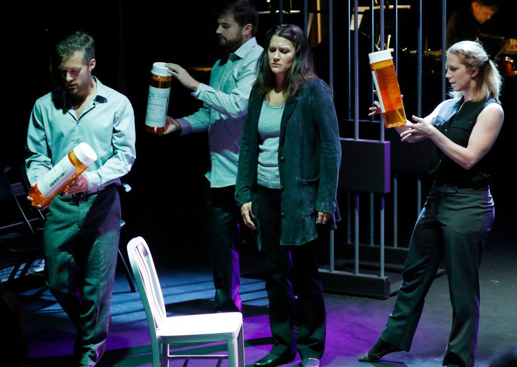 """From left: Trevor Martin, baritone; (from left), Andrew Surrena, tenor; Christina Pecce, soprano; and Anna Laurenzo, mezzo, take part in a dress rehearsal for Fort Worth Opera's Voir Dire at the McDavid Studio. Pecce portrays the ghost of Jeffrey Schumacher's mother, who tried to poison him over the years until the son murdered her. The outsize pill bottles represent the pills she was giving him to """"help"""" him with imaginary ailments. (David Woo/Staff Photographer)"""