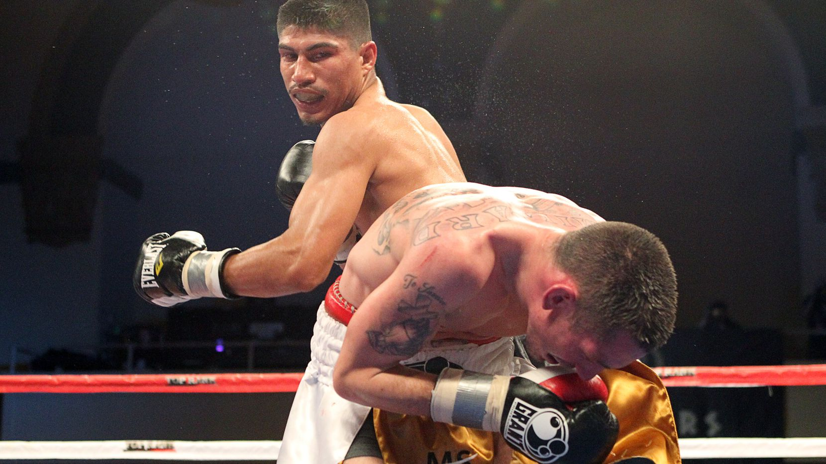 """ATLANTIC CITY, NJ - MARCH 26: Miguel Angel Garcia punches Matt Remillard during their NABF NABO Featherweight title fight during Top Rank's """"Featherweight Fury"""" on March 26, 2011 at Boardwalk Hall in Atlantic City, New Jersey. (Photo by Hunter Martin/Getty Images)"""