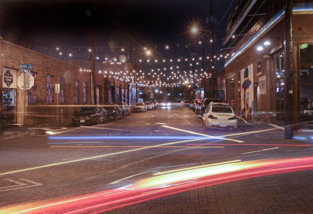 A time exposure captures automobile lights traveling though the intersection of Main and Crowdus streets in Deep Ellum.