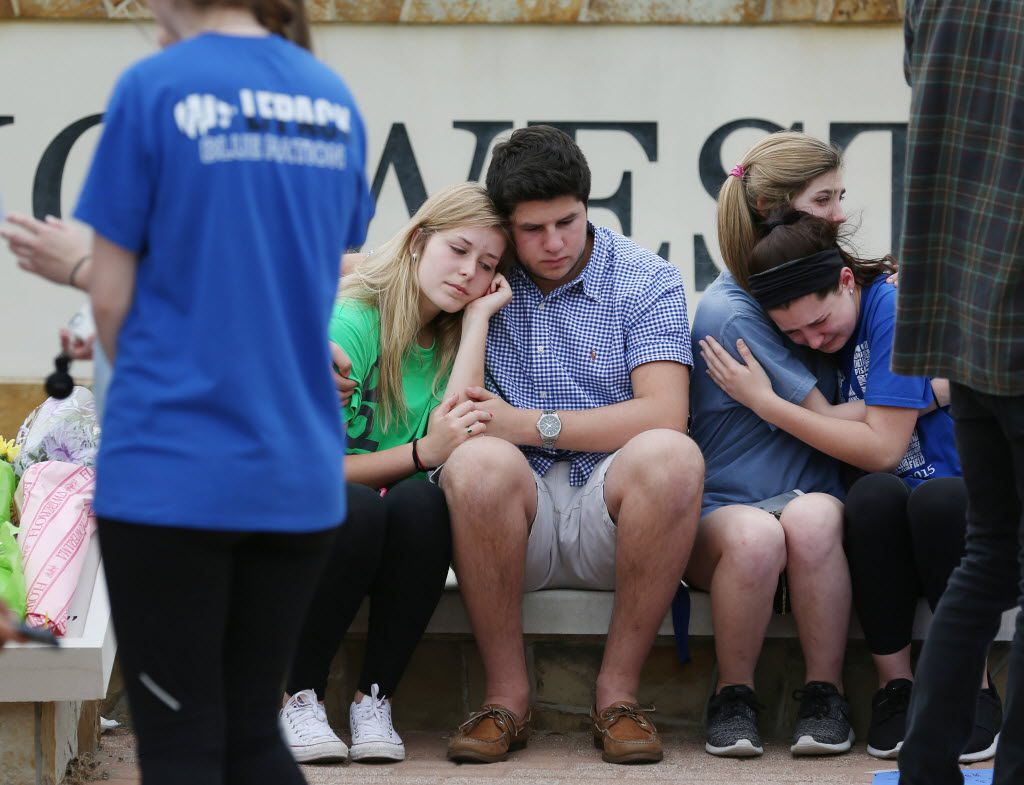 Students at Plano West High School grieve after the slaying of junior Josiah Utu. His brother McCann Utu Jr. stabbed Josiah and their mother to death and then took his own life.