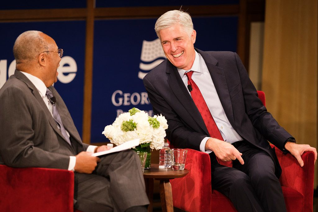 Supreme Court Justice Neil Gorsuch (right) speaks with moderator Larry D. Thompson at the Bush Center on Wednesday.