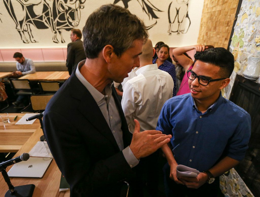 Presidential candidate Beto O'Rourke speaks with Christian Quintero, 20, following a round table event at Casa Komali restaurant on Thursday, May 30, 2019 in Dallas.