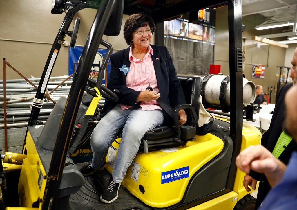 Democratic gubernatorial candidate Lupe Valdez sits in a forklift bearing one of her campaign stickers during a tour of the Texas Iron Workers Local 263 apprenticeship training facility in Grand Prairie on Thursday. She took a tour of the facility with a small group of union officials.