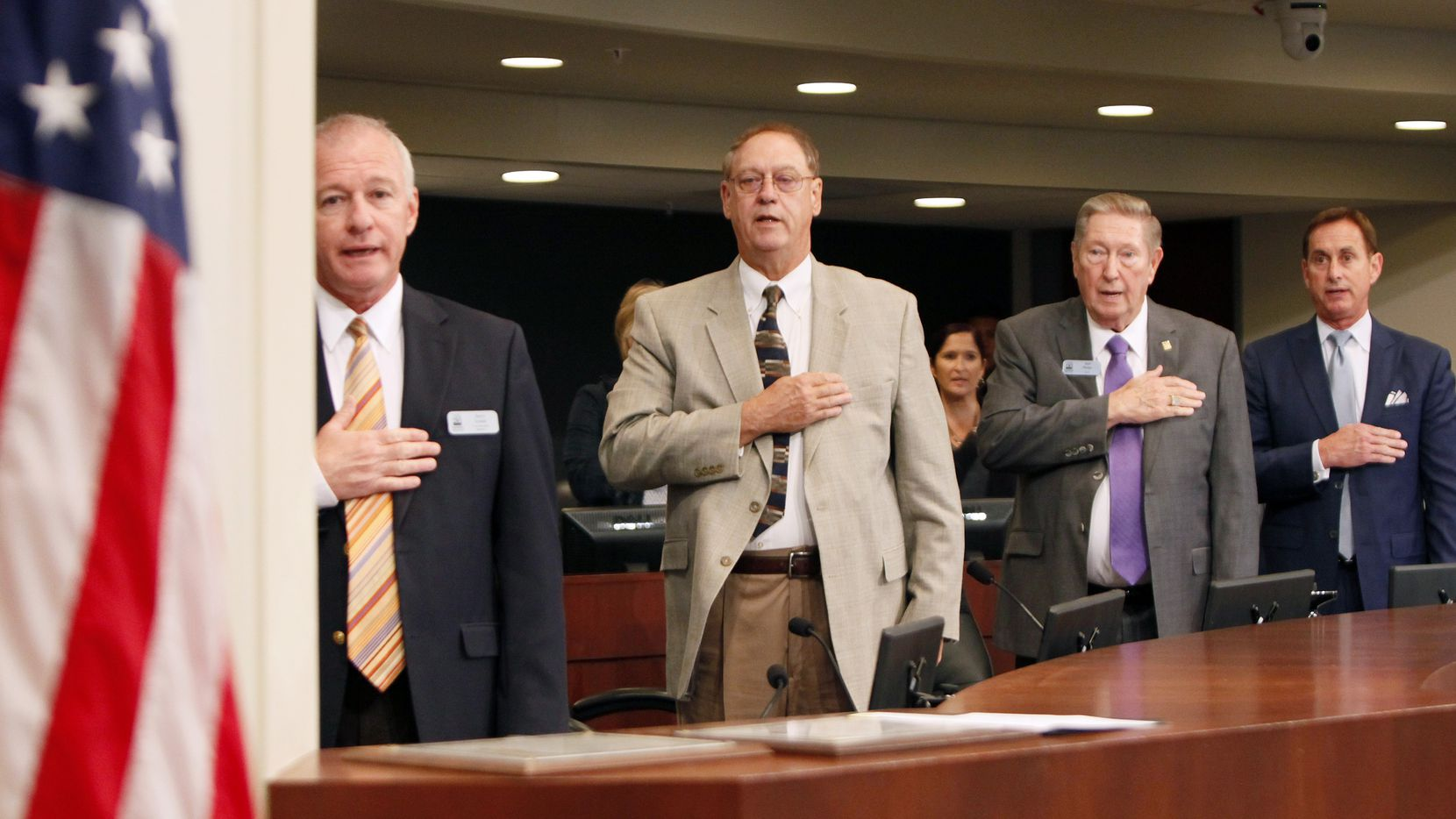 Farmers Branch Mayor Bob Phelps, third from left, stands with other council members during the Pledge of Allegiance before the start of a Farmers Branch City Council meeting, on Aug. 16, 2016 at Farmers Branch City Hall in Farmers Branch.