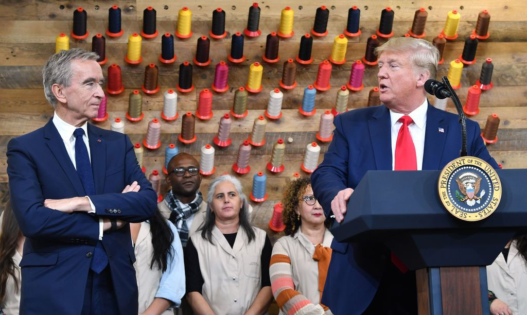 President Donald Trump, flanked by the chairman and CEO of LVMH, Bernard Arnault, speaks during a visit to the new Louis Vuitton factory in Alvarado.