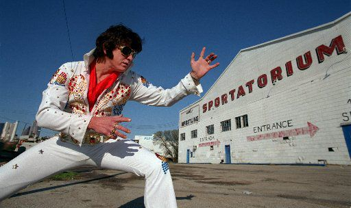 Elvis Presley impersonator Alan Curtis outside the Sportatorium, where the real Elvis played several times in the mid-1950s as part of the Big D Jamboree.