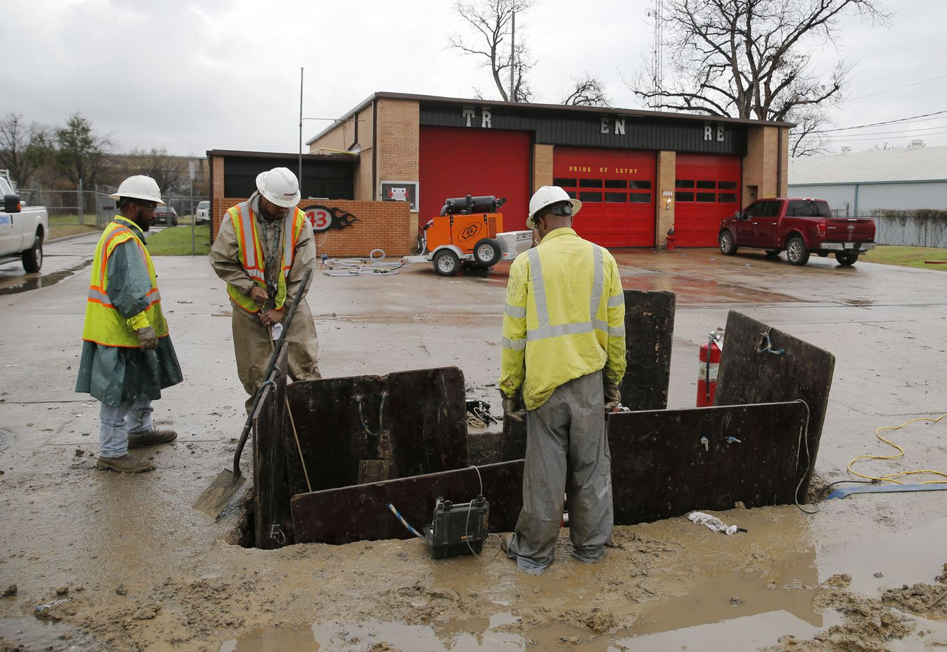 Construction crews work on a gas line in front of Dallas Fire Station 43 in Dallas on Wednesday, February 28, 2018. A gas leak forced the evacuation of a northwest Dallas fire station Tuesday evening not far from where a house exploded last week. (Vernon Bryant/The Dallas Morning News)