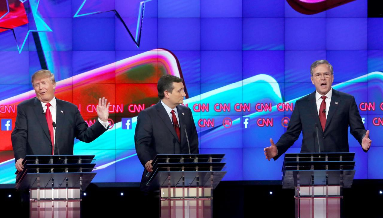 With Ted Cruz positioned between them, Donald Trump and Jeb Bush sparred frequently in Tuesday night's Republican presidential debate in Las Vegas. The Texas senator, enjoying a lead in Iowa polls, was a target for many of his rivals onstage.