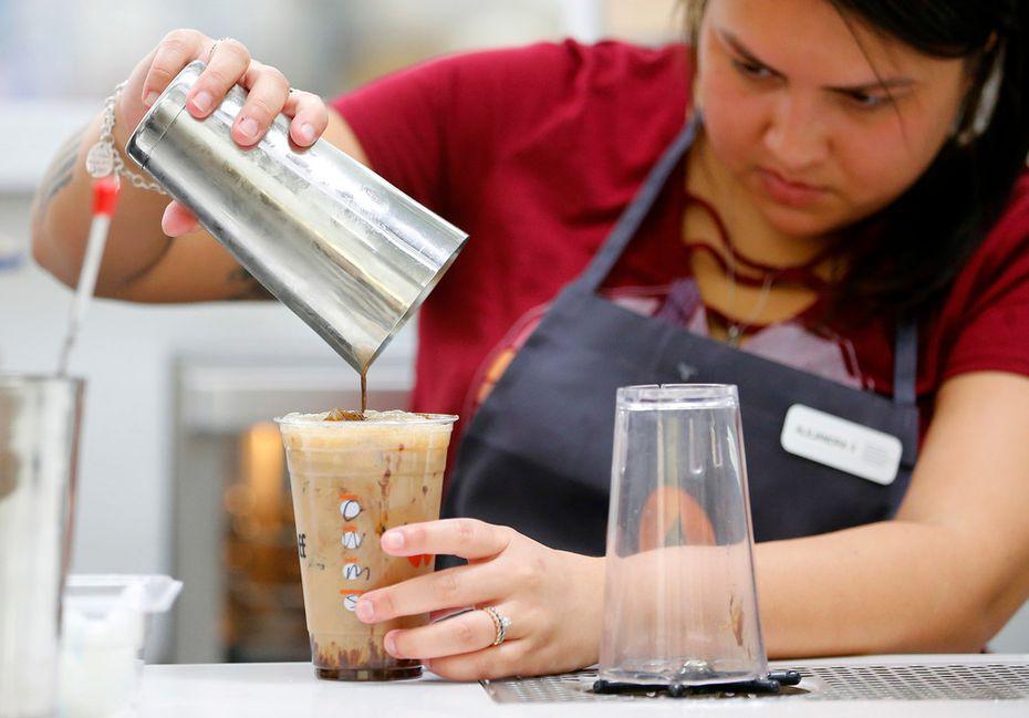 "LiftOff Coffee and Tea ""pilot"" Alejandra Velasquez crafts a cold coffee inside Walmart Supercenter on Interstate 30 in Garland."