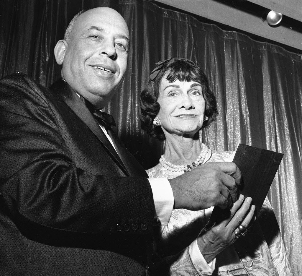 """Fashion designer Gabrielle """"Coco"""" Chanel, right, receives the Neiman-Marcus fashion award for 1958 from Stanley Marcus, president of Neiman-Marcus Co., in Dallas on Sept. 9, 1957.   The celebration marked the 50th anniversary of the Dallas luxury.  (AP Photo)"""