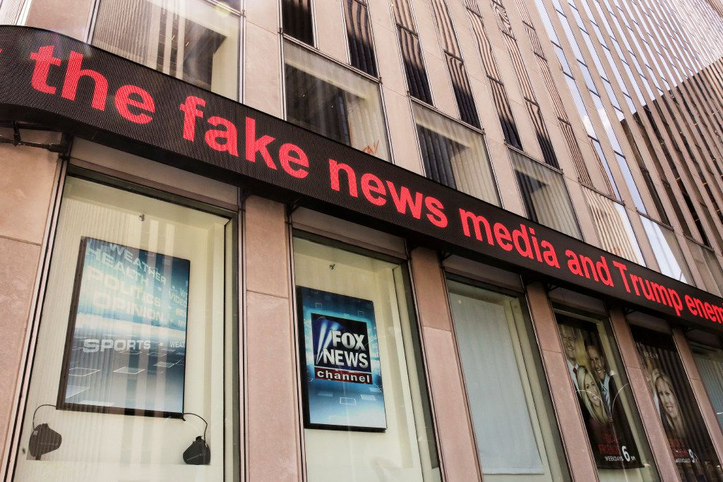 News headlines scroll above the Fox News studios in the News Corporation headquarters building in New York, Tuesday, Aug. 1, 2017.