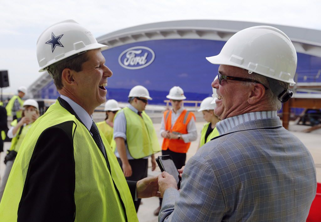 Frisco ISD superintendent Dr. Jeremy Lyon shares a laugh with Dallas Cowboys director of player personnel Stephen Jones before a topping off ceremony at the Omni Frisco Hotel at The Star in Frisco on Wednesday, July 27, 2016. (Vernon Bryant/The Dallas Morning News)