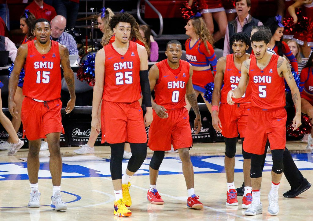 Southern Methodist Mustangs forwards Isiaha Mike (15) and Ethan Chargois (25), guards Jahmal McMurray (0) Jimmy Whitt Jr. (33) and Nat Dixon (5) walk to the bench during a second half timeout against the Connecticut Huskies at Moody Coliseum in University Park, Texas, Thursday, February 21, 2019. (Tom Fox/The Dallas Morning News)