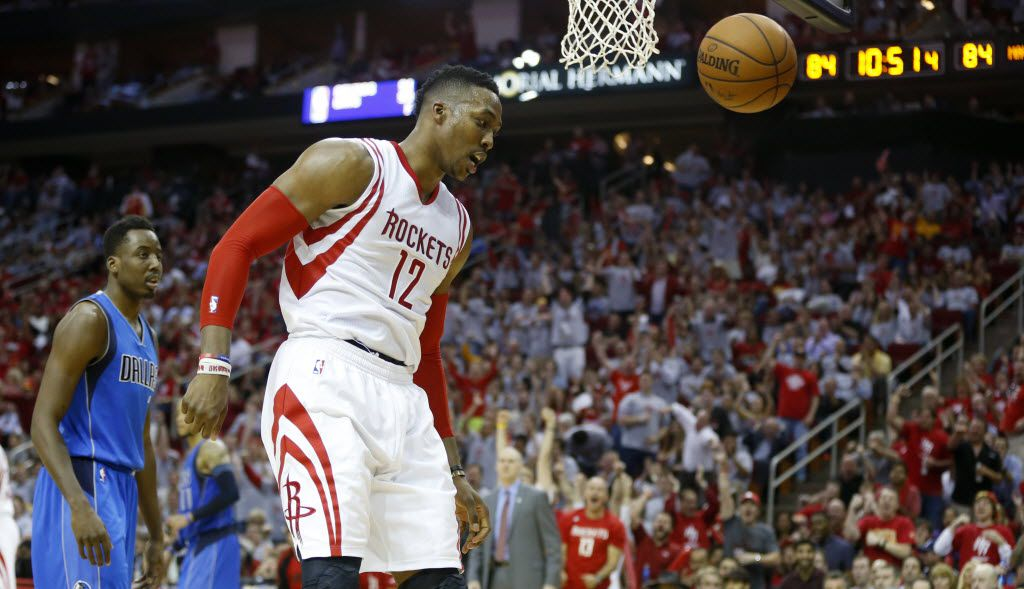 Houston Rockets center Dwight Howard (12) head buts the ball after a dunk during the second half of game 2 of the first round of the NBA playoffs at Toyota Center in Houston on Saturday, April 21, 2015. The Dallas Mavericks lost to the Houston Rockets 111-99. (Vernon Bryant/The Dallas Morning News)