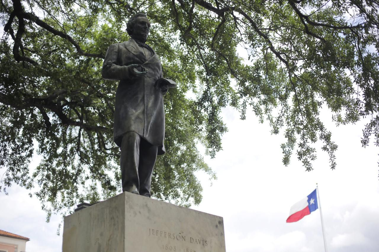 A statue of Jefferson Davis is seen on the University of Texas campus, Tuesday, May 5, 2015, in Austin, Texas. The University of Texas student government passed a resolution recently to remove the statue of Jefferson Davis from a prominent space on the university campus.