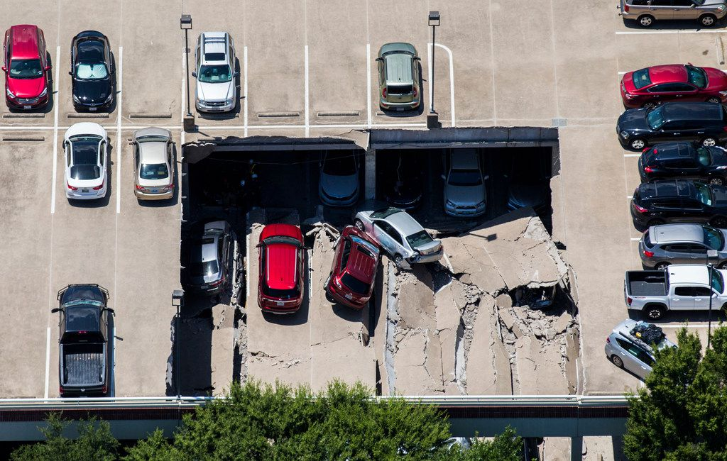 Emergency crews respond to a collapsed parking garage at 4545 Fuller Road in Irving, Texas, on Tuesday, July 31, 2018.