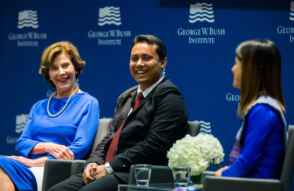 Former first lady Laura Bush speaks on a panel with graduates Aung Kyaw Moe (center) and Ei Ei Phyu at the graduation of the 2017 class of the Bush Institute's Liberty and Leadership Forum on Monday, June 26, 2017 at the George W. Bush Presidential Center on the campus of Southern Methodist University in Dallas.