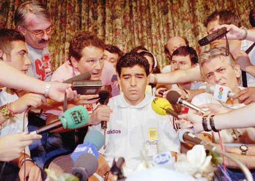 DIEGO MARADONA Caption: Argentina World Cup soccer player Diego Maradona is the  center of media attention at The Sheraton Park Plaza hotel in  Dallas, Texas, Thursday night, June 30, 1994. The Argentina Football Association dropped the 33-year-old forward from their  World Cup soccer squad just hours before the team's final first  round game against Bulgaria, after it was revealed that he had  tested positive for the use of banned drugs. (AP Photo/Tim Sharp)  Photographer: TIM SHARP07092014xALDIA