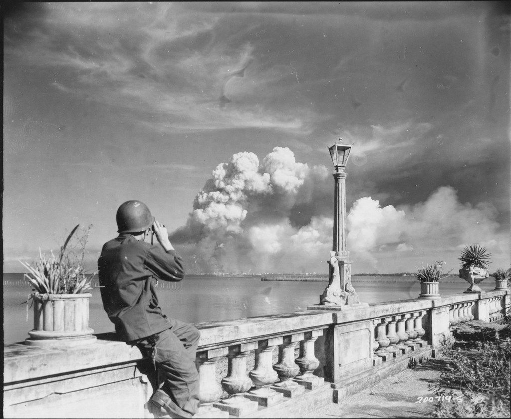 An American soldier watches Manila burn from the beach at Paranque on Feb. 8, 1945. From Rampage: MacArthur, Yamashita and the Battle of Manila, by James M. Scott.