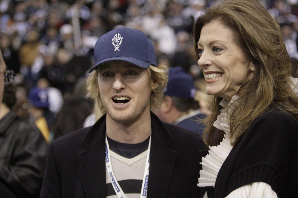Actor Owen Wilson stands with Charlotte Jones on the Dallas Cowboys sideline