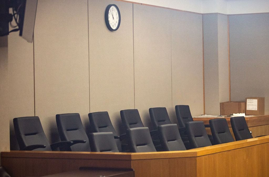 An empty jury box  at the Frank Crowley Courthouse.