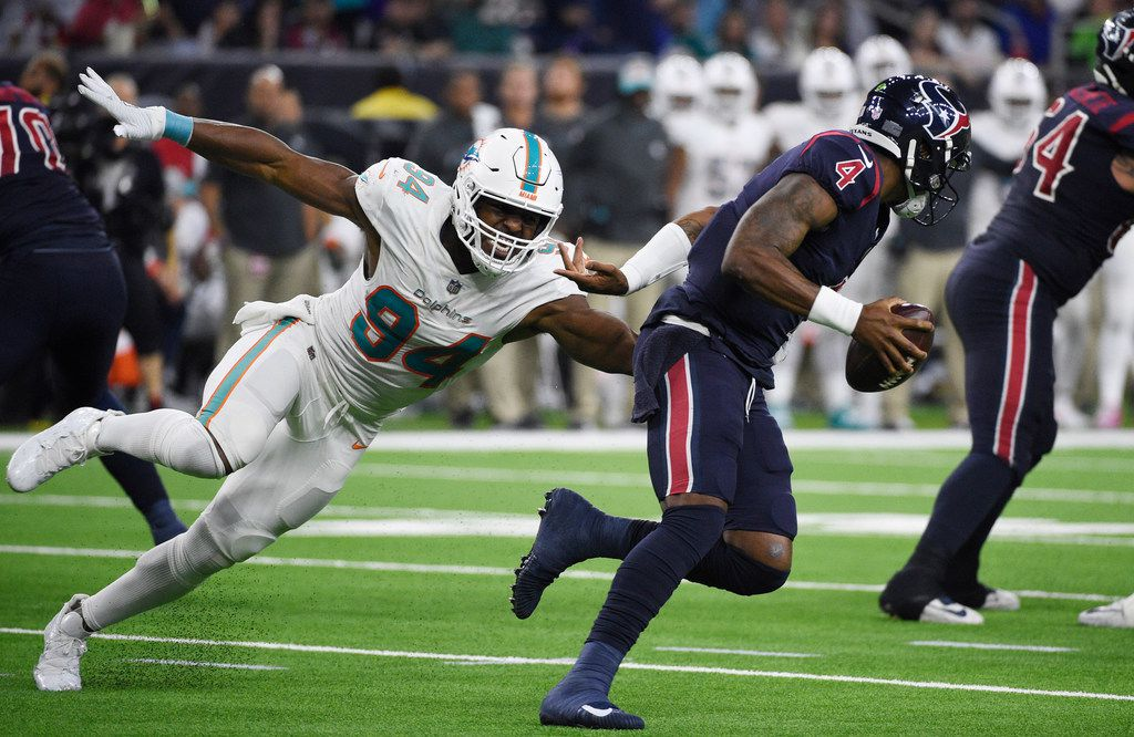 FILE - In this Oct. 25, 2018, file photo, Houston Texans quarterback Deshaun Watson (4) is pressured by Miami Dolphins defensive end Robert Quinn (94) during the second half of an NFL football game in Houston. (AP Photo/Eric Christian Smith, File)