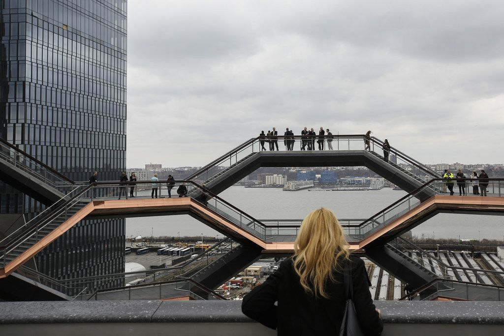 Visitors walk through the Vessel, a public art structure consisting of 155 flights of stairs, on the opening day for phase one of the Hudson Yards development on the West Side of Midtown Manhattan on  March 15, 2019 in New York City. The development will include four towers, including residential, commercial and retail space, The developer of the project, Related Companies, calls it the most expensive endeavor in the city since Rockefeller Center.