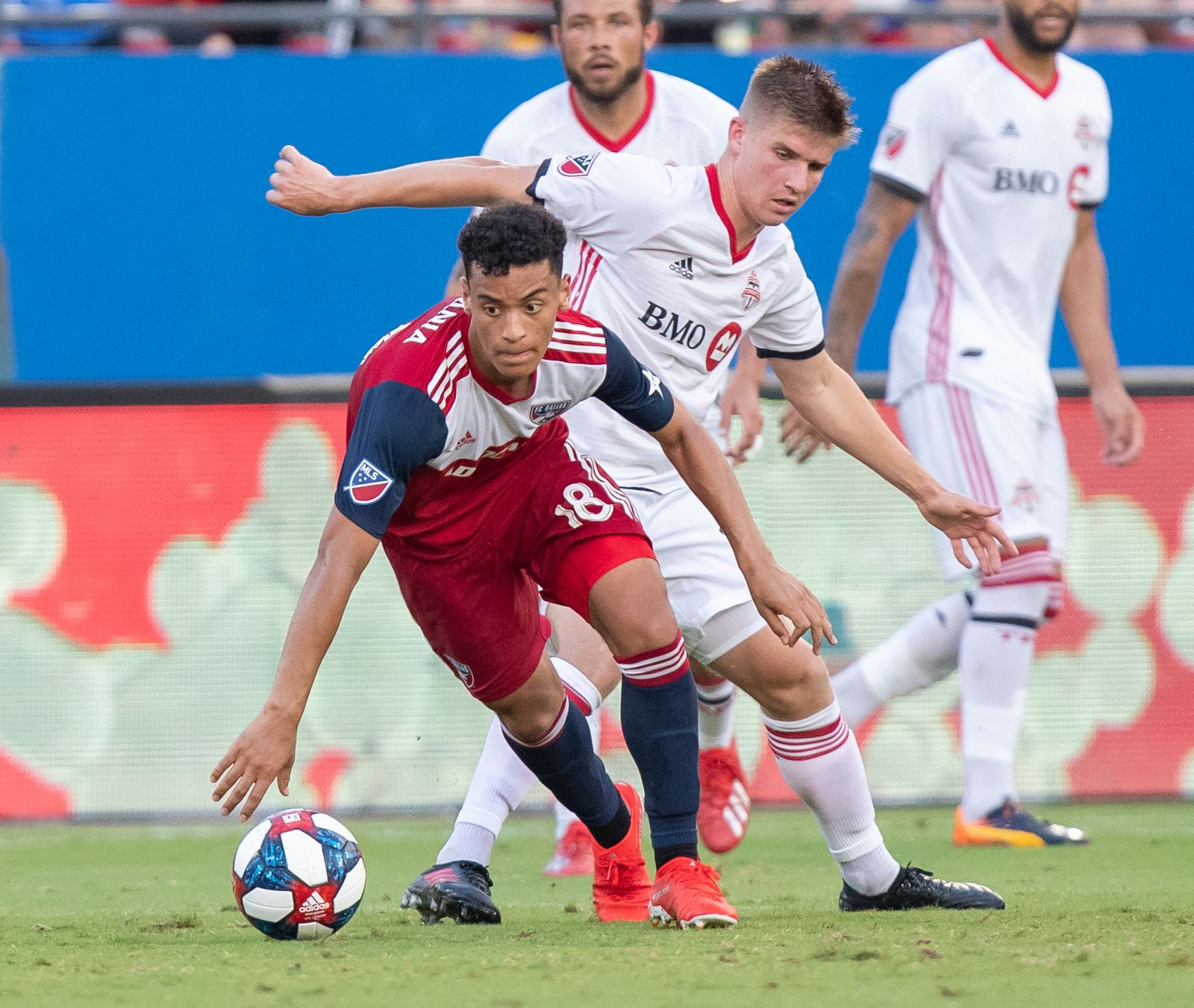 DALLAS, TX - JUNE 22: Brandon Servania dribbled out of traffic during the MLS soccer game between FC Dallas and Toronto FC on June 22, 2019 at Toyota Stadium in Frisco, Texas.  (Photo by Matthew Visinsky)