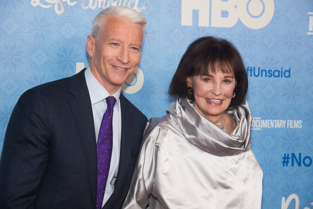"""In this April 4, 2016 file photo, CNN anchor Anderson Cooper and Gloria Vanderbilt attend the premiere of """"Nothing Left Unsaid"""" at the Time Warner Center in New York. Vanderbilt, the """"poor little rich girl"""" heiress at the center of a scandalous custody battle of the 1930s and the designer jeans queen of the 1970s and '80s, died on Monday, June 17, 2019, at 95, according to her son, Cooper. (Photo by Charles Sykes/Invision/AP, File)"""