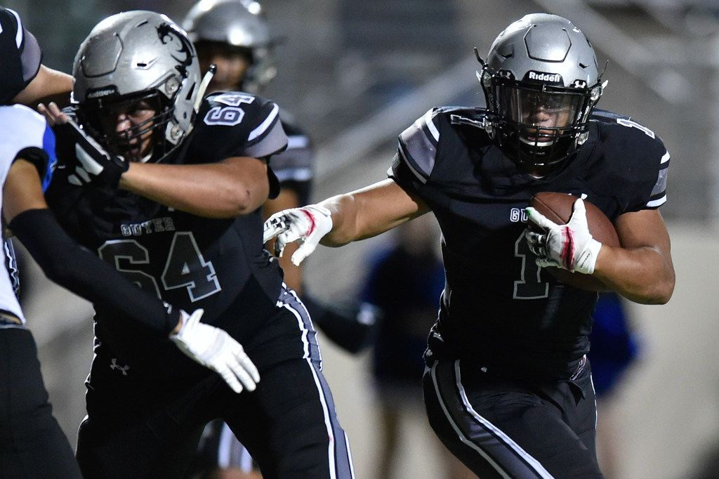 Guyer running back Kaedric Cobbs (1) rushes the ball and scores a touchdown against the Nelson defense at C.H. Collins Athletic Complex.