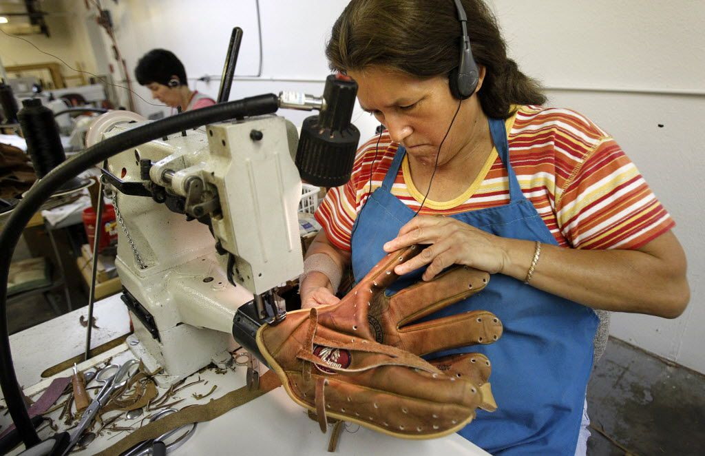 Adela Camarillo sews the two sides of a Nokona baseball glove together and binds the leather halves at Nocona Athletic Goods, one of the few companies that manufacture baseball gloves in the U.S.  Under the Nokona brand they have been producing gloves for years. September 22, 2010. (Tom Fox/The Dallas Morning News)