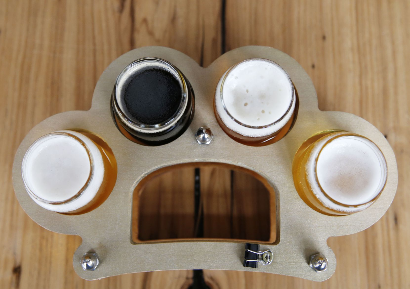 Flights of beer come served in a tray shaped like brass knuckles at Austin Beerworks.