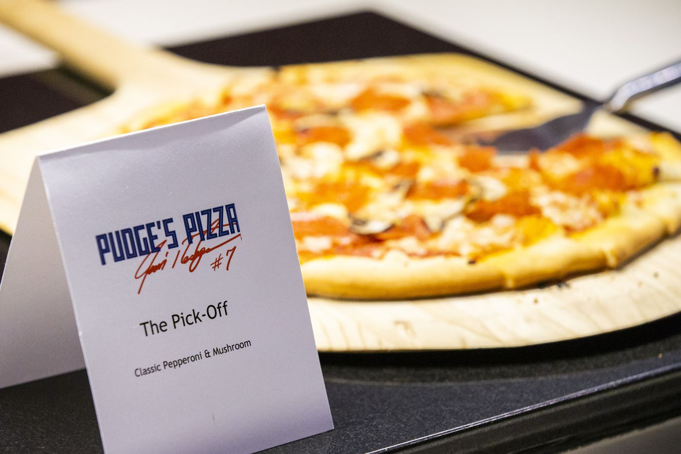 """Samples of pizza that will be offered at Pudge's Pizza, a  restaurant by Hall of Fame Texas Rangers catcher Ivan """"Pudge"""" Rodriguez at the Texas Live! development, are offered on a buffet during a press event at Globe Life Park."""