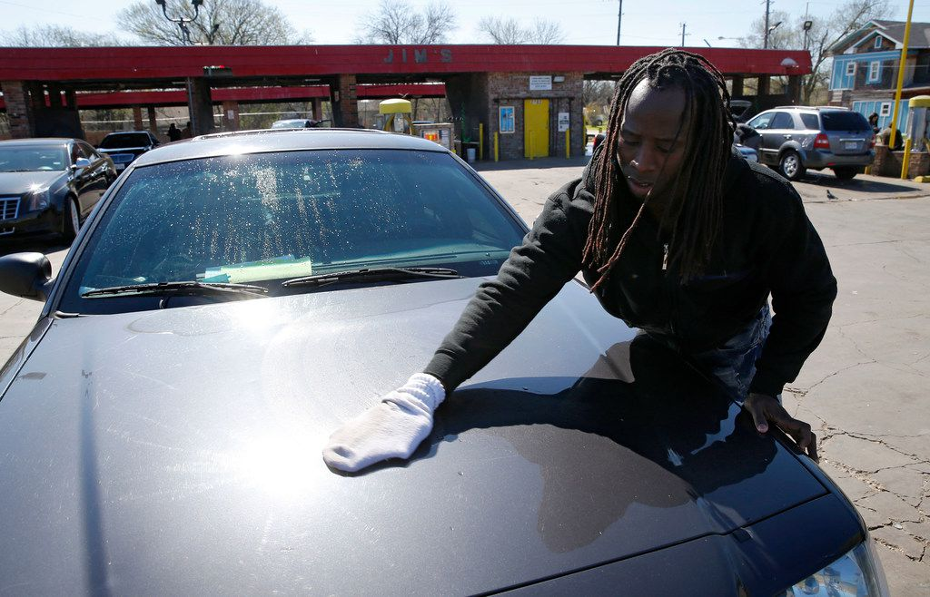 Tyrone Jackson dries his car at Jim's Car Wash on Martin Luther King Jr. Boulevard in Dallas.
