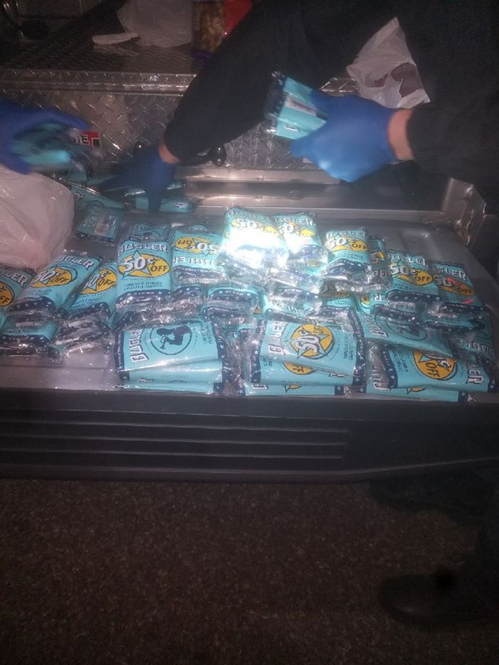 There were dozens of packages of Bugler tobacco in the duffel bag.