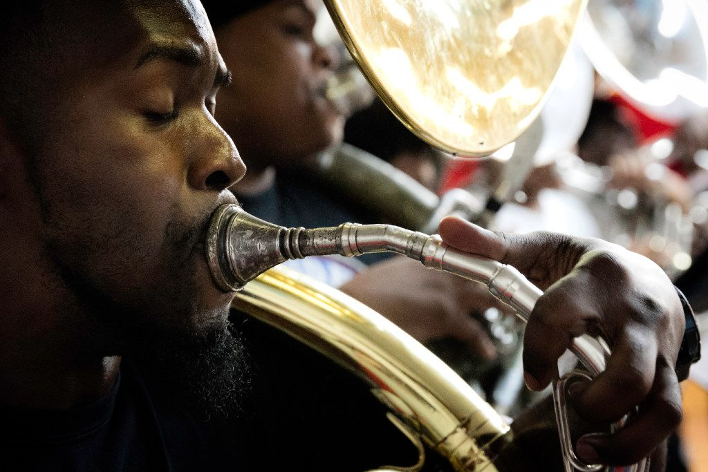 Markel Hall plays the tuba.  Hall is the band director at South Oak Cliff High School and helps instruct the Dallas Mass practice during the summer.