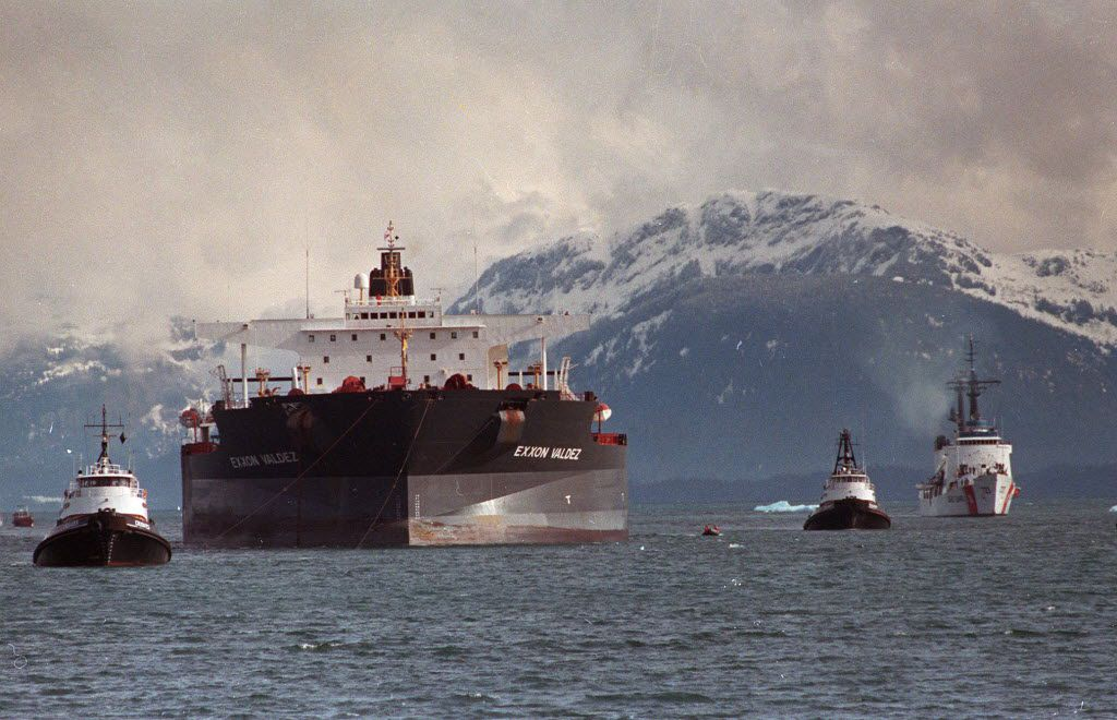 In this June 23, 1989 file photo, the Exxon Valdez is towed out of Prince William Sound in Alaska by a tug boat and a U.S. Coast Guard Cutter.