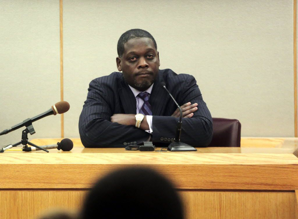 Then-Dallas County District Attorney Craig Watkins took the stand during a 2013 hearing. Watkins was held in contempt of court after he refused to answer questions about whether his office prosecuted an oil fortune heir as a favor to a friend and campaign donor. He later was acquitted by a judge who said the hearing should not have been held. (File Photo/Ron Baselice)