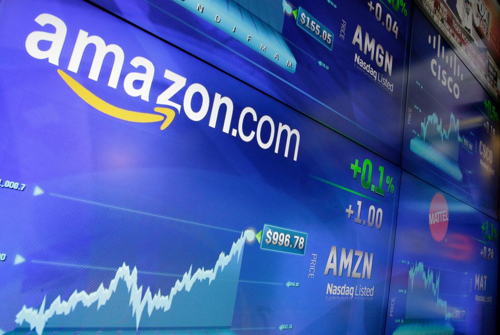 FILE - In this Tuesday, May 30, 2017, file photo, the Amazon logo is displayed at the Nasdaq MarketSite, in New York's Times Square. Amazon announced Thursday, Sept. 7, that it has opened the search for a second headquarters, promising to spend more than $5 billion on the opening. (AP Photo/Richard Drew, File)