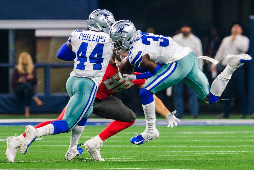 Dallas Cowboys defensive back Donovan Wilson (37) steps in front of Tampa Bay Buccaneers tight end Tanner Hudson (88) to intercept a pass as *linebacker Justin Phillips (44) defends during the first half of an NFL preseason football game at AT&T Stadium on Thursday, Aug. 29, 2019, in Arlington. (Smiley N. Pool/The Dallas Morning News)