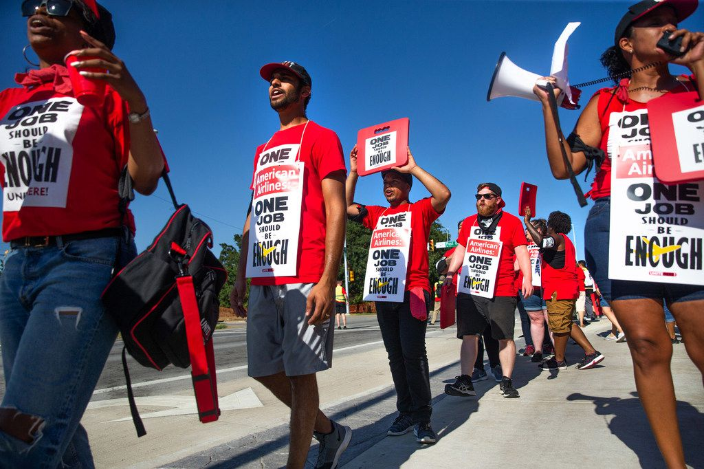 Protestors marched outside the new corporate headquarters for American Airlines in Fort Worth to protest employee wages and benefits at LSG Sky Chefs on Aug. 13.